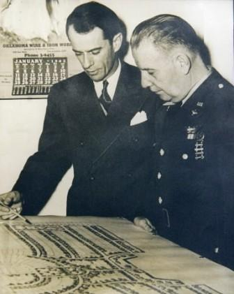 Bill Atkinson and Commander Turnbull review plans for Midwest City. Photos courtesy of the Atkinson Center.