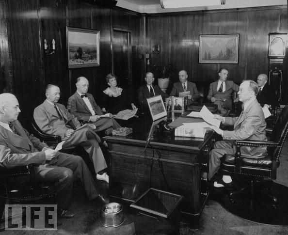 Oklahoman publisher E.K. Gaylord meets with his editorial staff, circa 1940s.