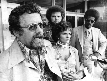 "Pody Poe at a 1975 press conference outside the federal courthouse, with ""Barbara No. 2"" and a groovy assortment of characters at his side."